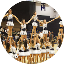 THHS cheerleaders forming a pyramid