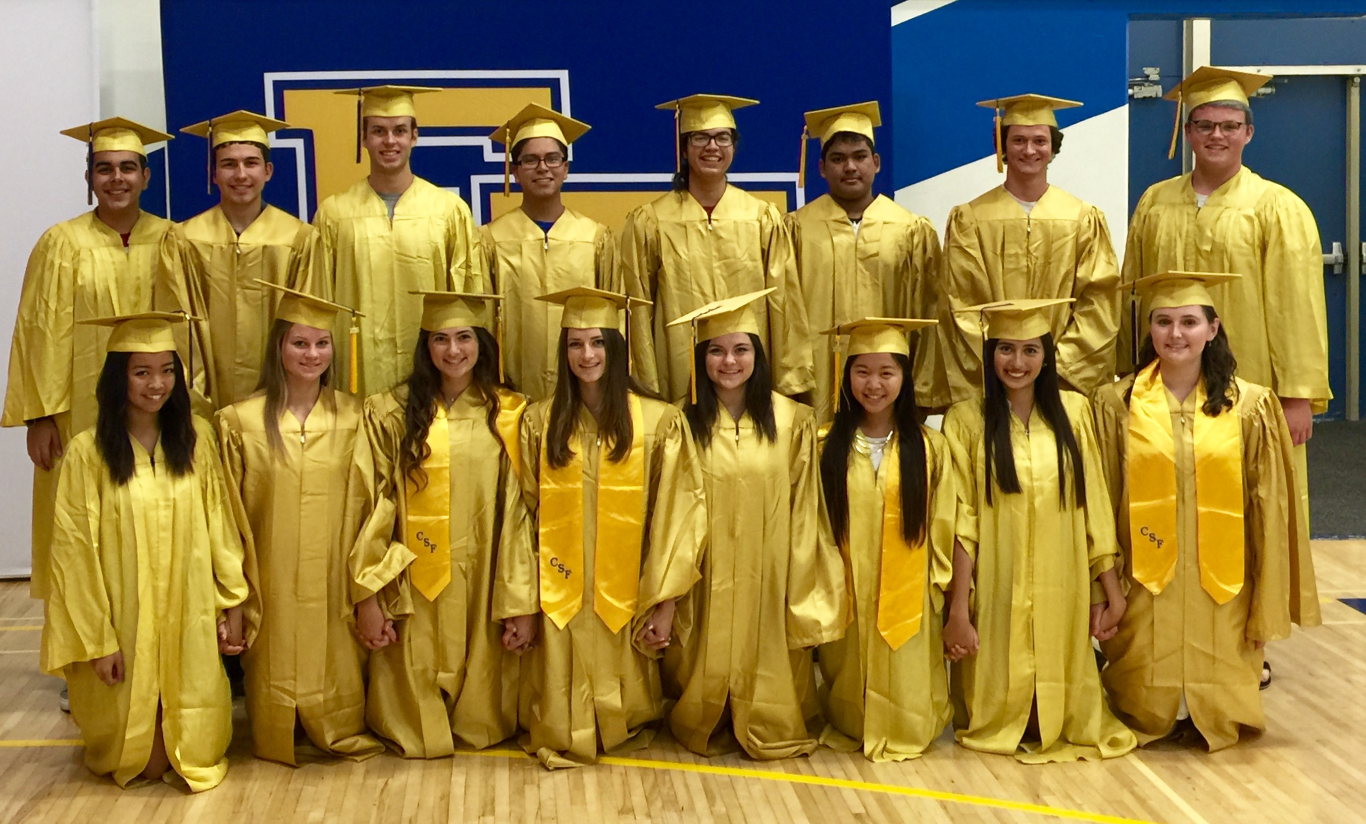 picture of class of 2016 IB in gold robes