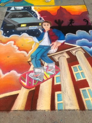 chalk drawing of boy on skateboard
