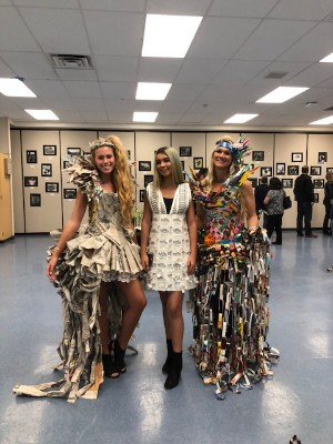 teacher and students pose in wearable art creations