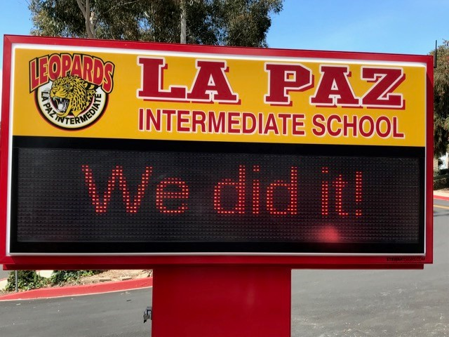 "marquee saying ""We did it!"""